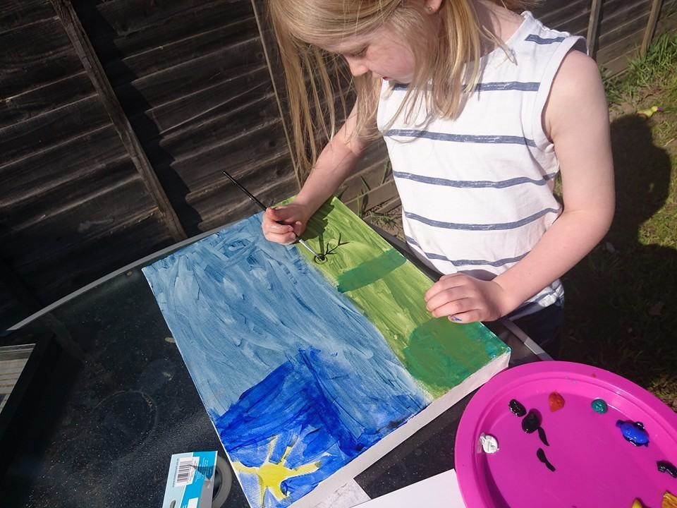 Kid painting picture