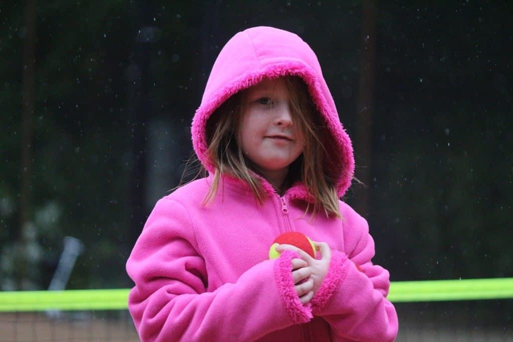 girl tennis ball rain tennis lessons